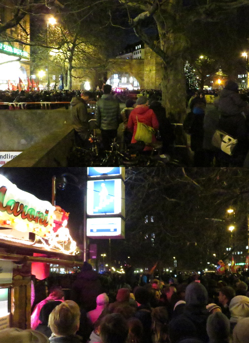 Die NoBagidaMuc-Demo gegen Muegida am Sendlinger Tor in München. Oben in der Mitte ist der leere Bereich der Muegida-Anhänger zu sehen. Unten: Lieber Maroni als Muegida!